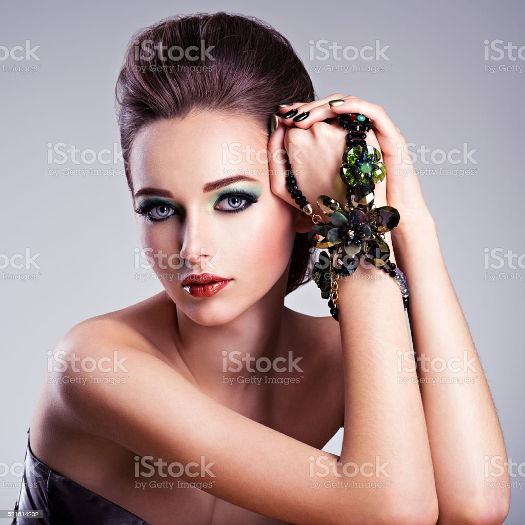Beautiful woman face with fashion green make-up stock photo