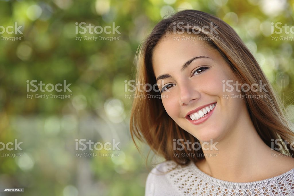 Beautiful woman facial with a perfect white smile stock photo