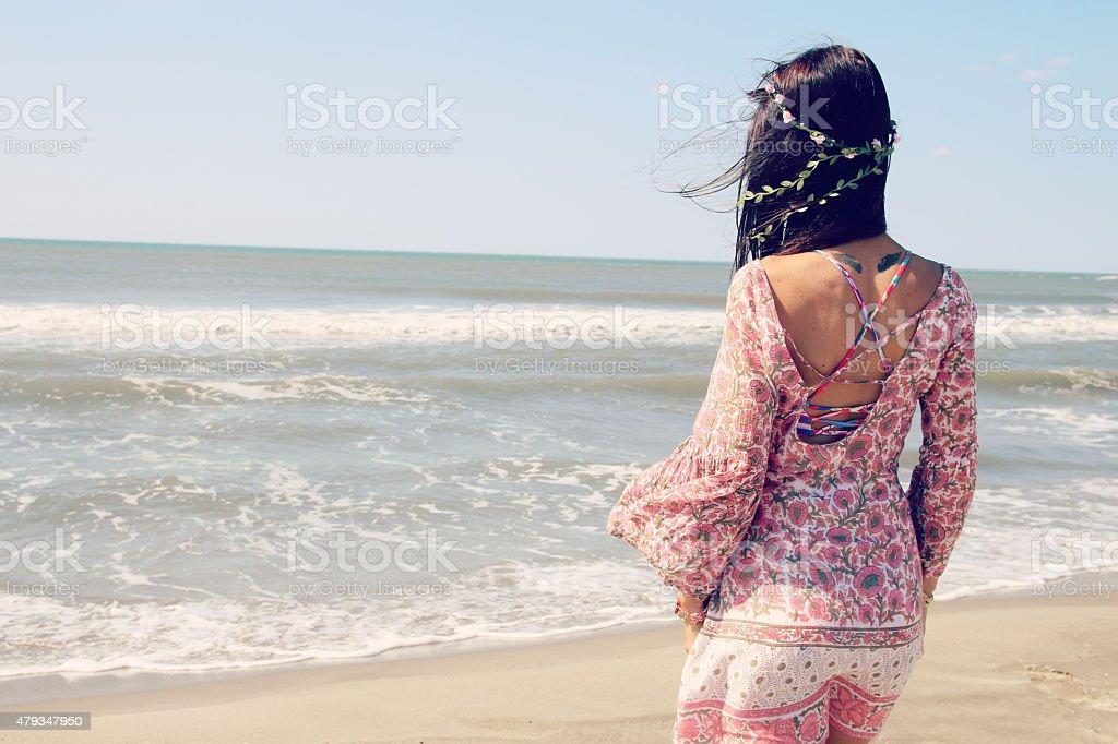beautiful woman facing the sea stock photo