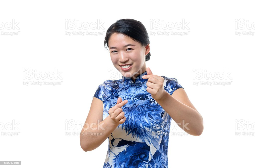 Beautiful woman gesturing a love sign stock photo