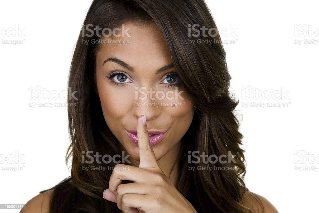 Beautiful woman gesturing quiet stock photo