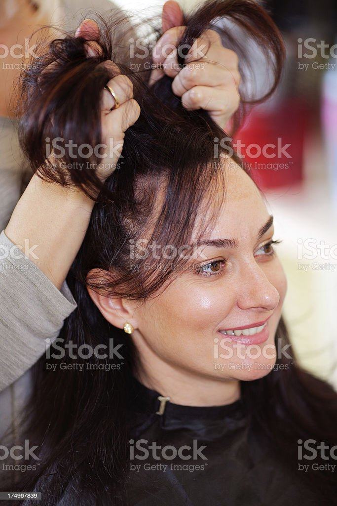 Beautiful woman getting hairstyle royalty-free stock photo