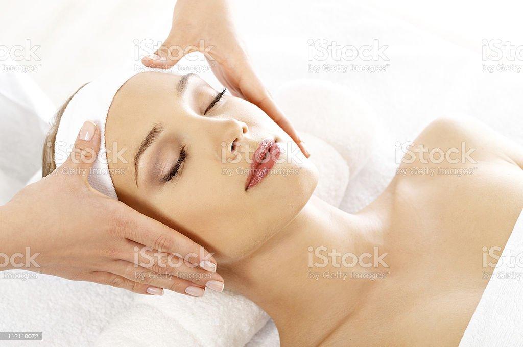 Beautiful woman getting relaxing facial treatment stock photo