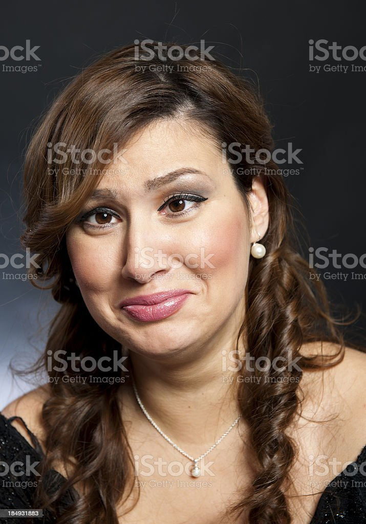 Beautiful woman grimacing royalty-free stock photo