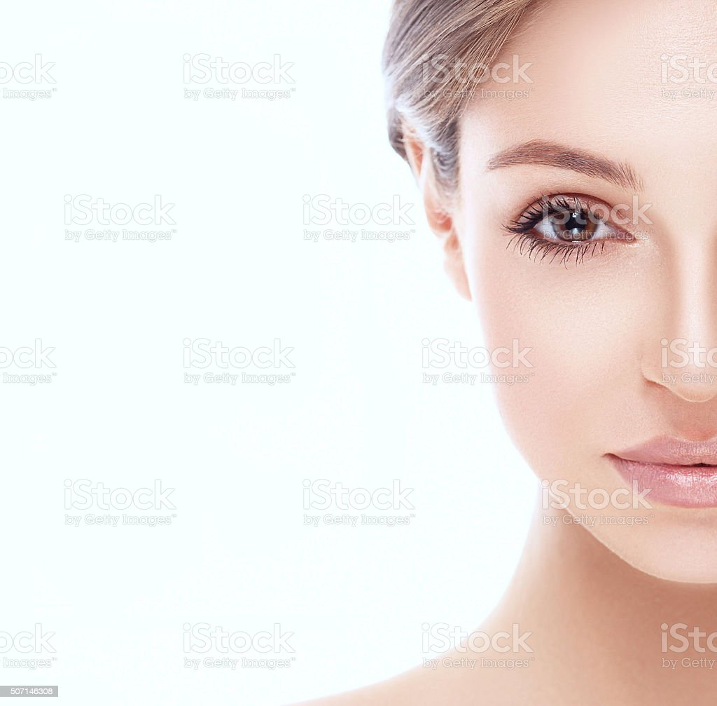 Beautiful woman half-face close up studio isolated on white background stock photo