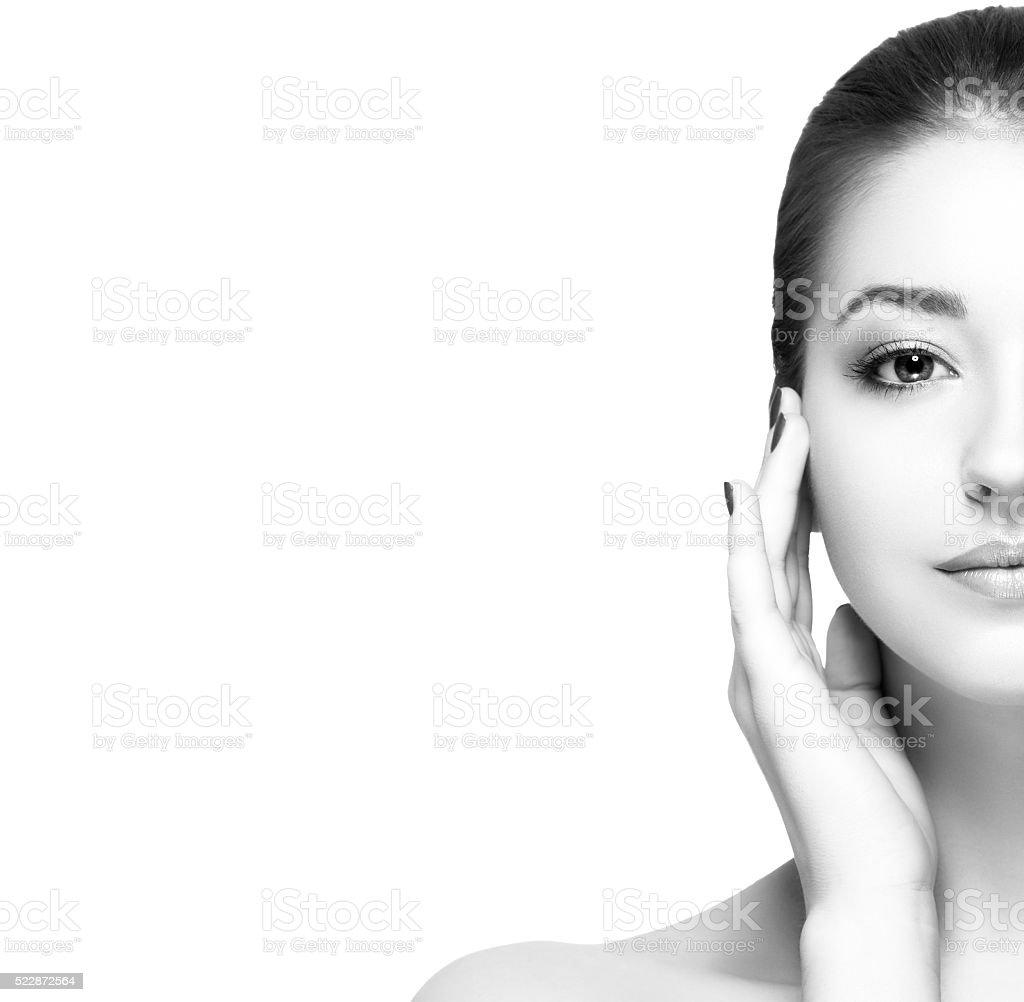 Beautiful woman half-face studio black and white stock photo