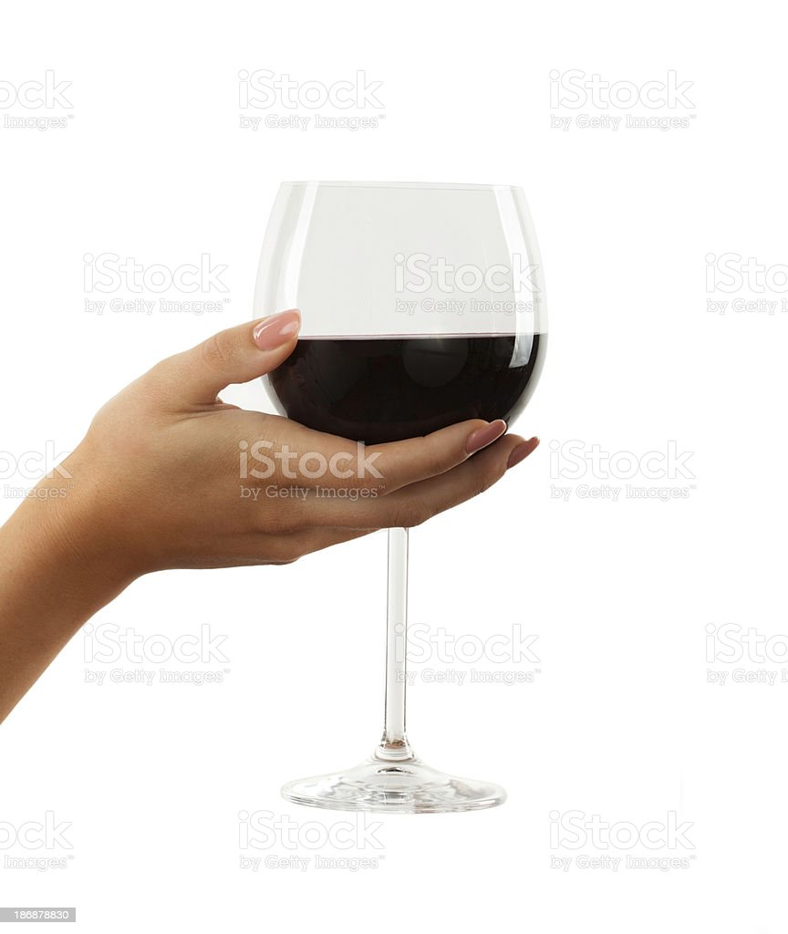 Beautiful woman hand holding glass of red wine isolated royalty-free stock photo