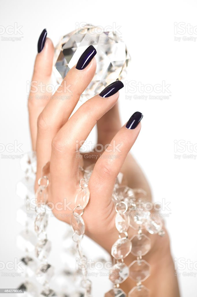 Beautiful woman hands with big diamond stock photo