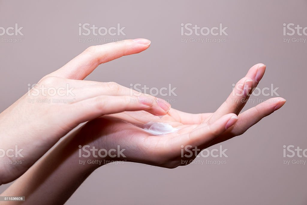 beautiful woman hands with cream stock photo