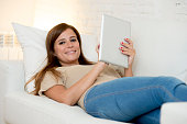 beautiful woman happy working home with digital tablet computer pad