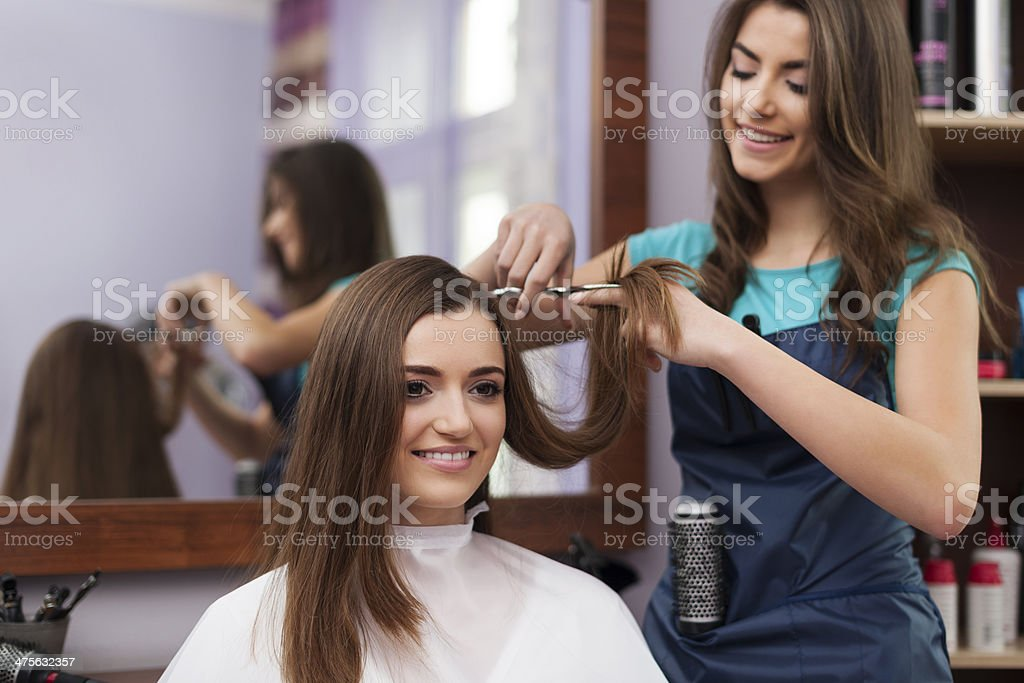 Beautiful woman has cutting hair at the hairdresser stock photo