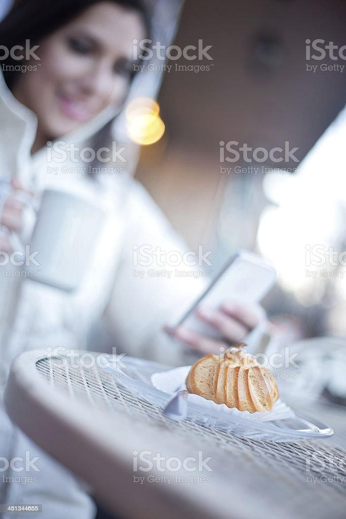 Beautiful Woman Having a Cup of Coffee Outside royalty-free stock photo