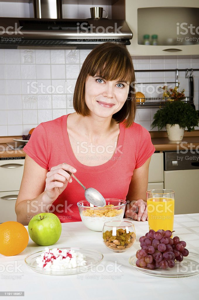 Beautiful woman having a healthy breakfast royalty-free stock photo