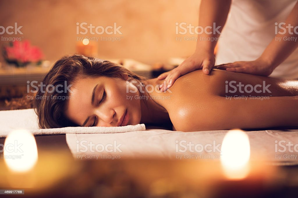 Beautiful woman having a massage at the spa. stock photo