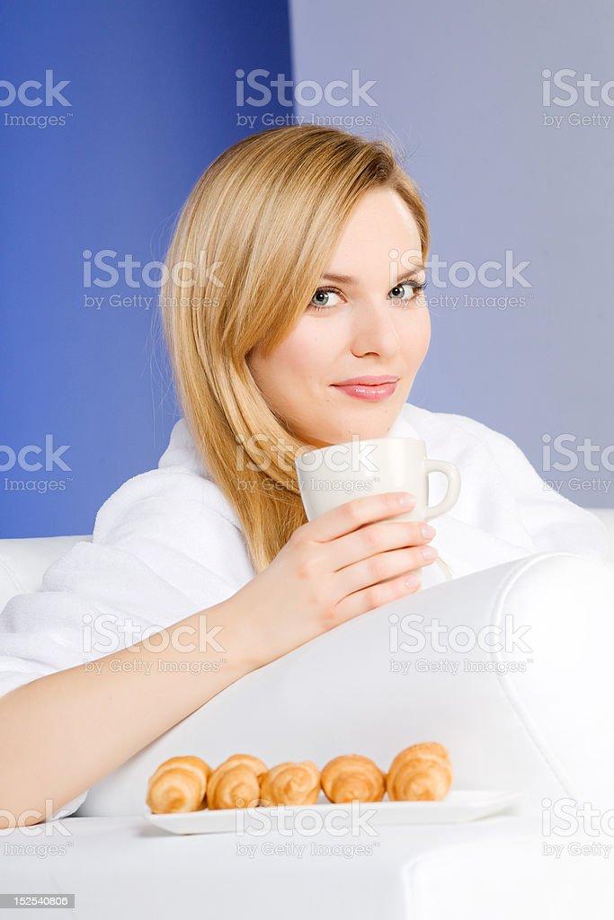 Beautiful woman having breakfast at morning royalty-free stock photo