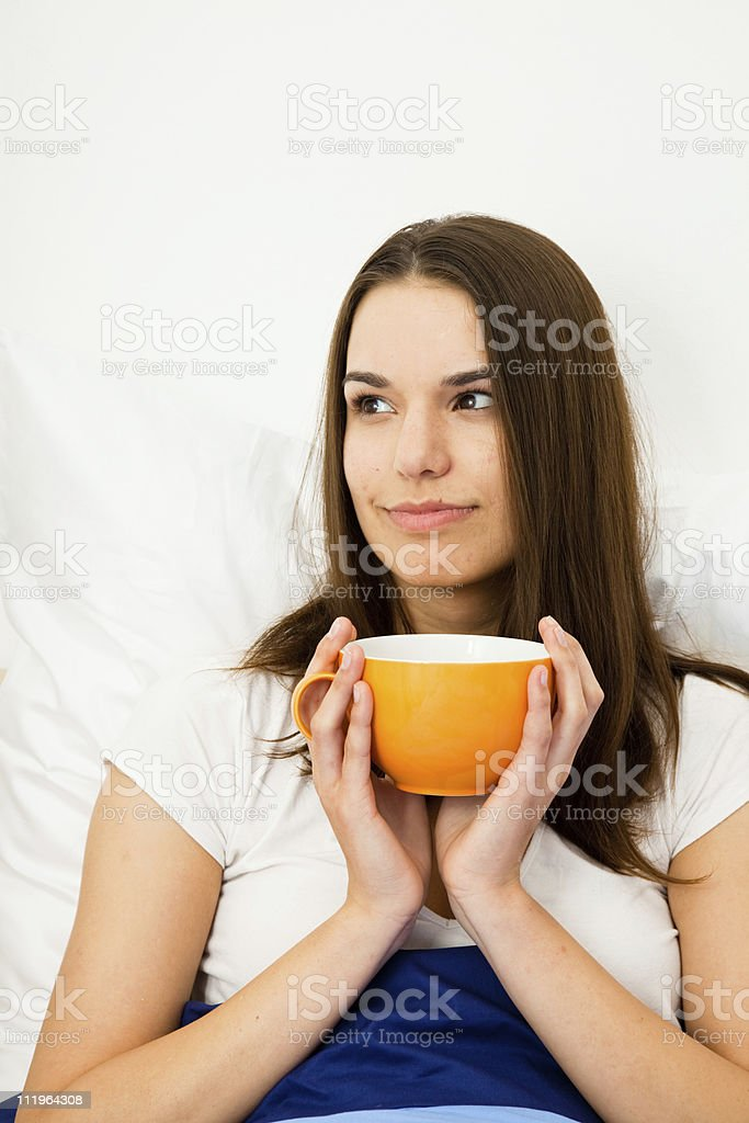 beautiful woman having coffee in bed royalty-free stock photo