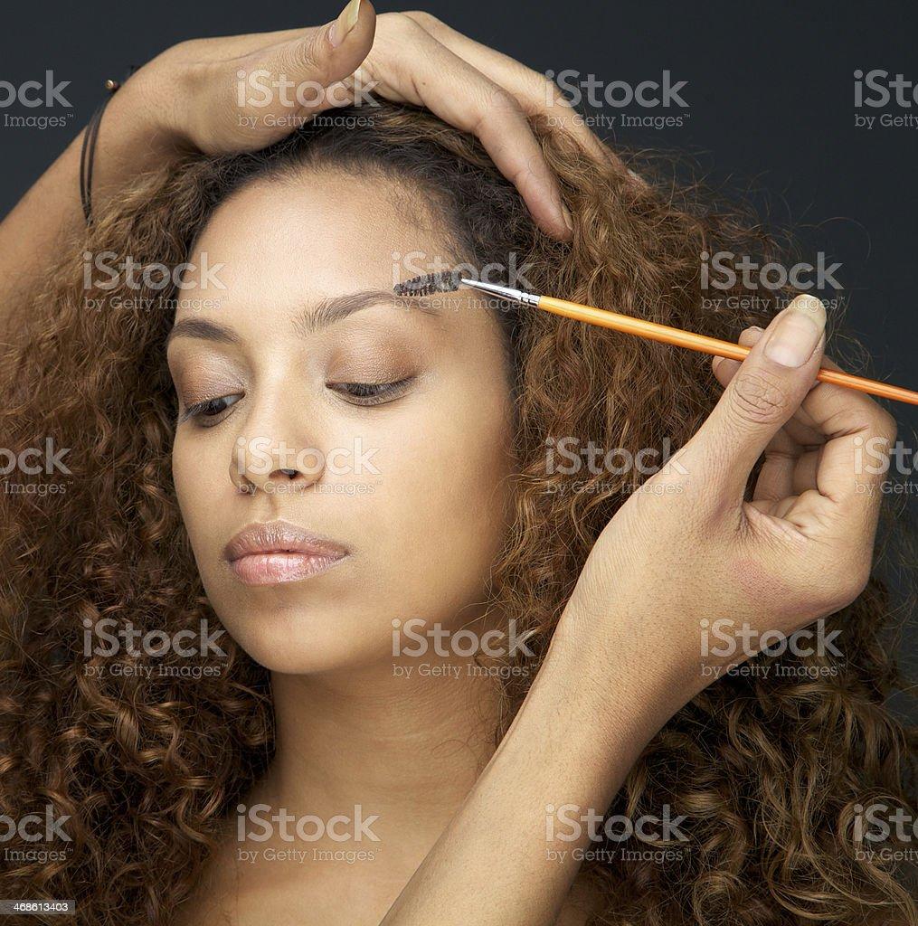Beautiful woman having eye make up application from professional royalty-free stock photo