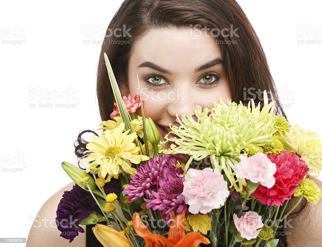 Beautiful Woman Hiding Behind Flowers royalty-free stock photo