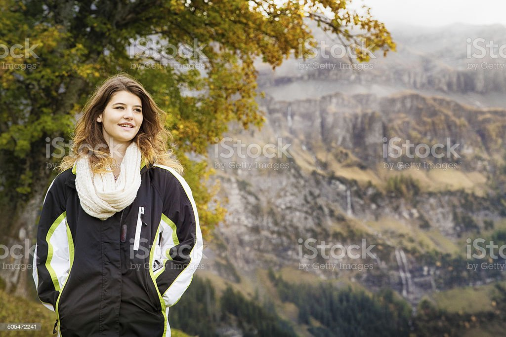 Beautiful woman hiking in the Swiss Alps stock photo