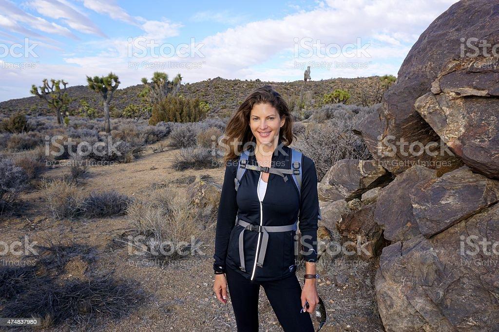 Beautiful woman hiking stock photo