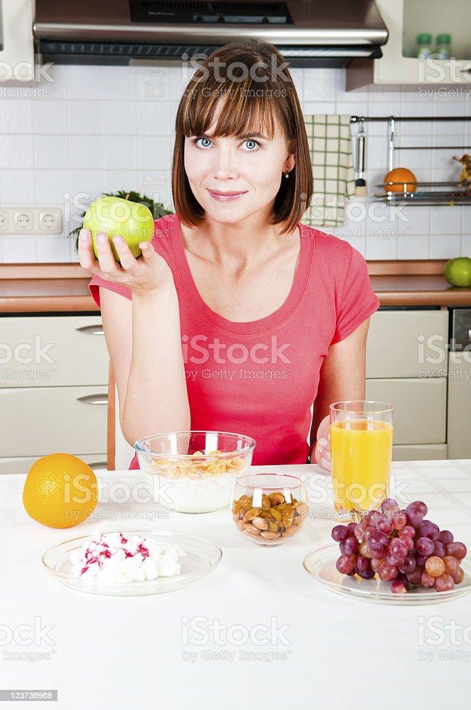 beautiful woman holding a apple royalty-free stock photo