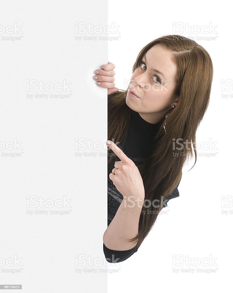 beautiful woman holding a blank billboard royalty-free stock photo