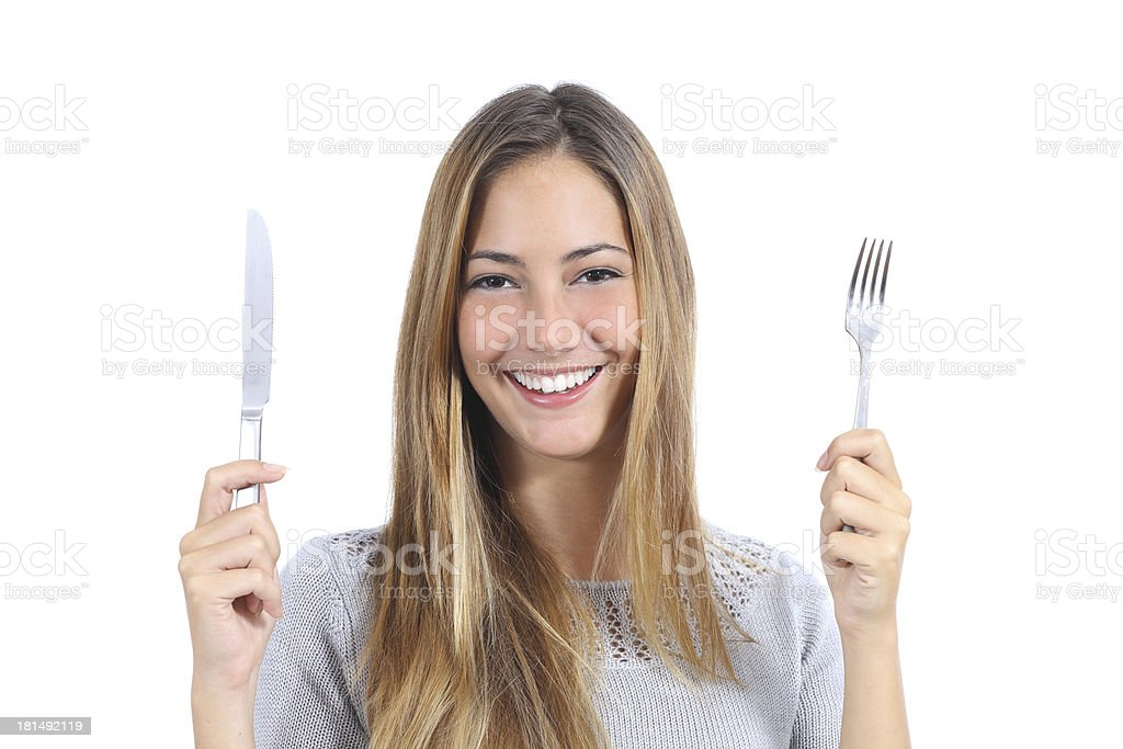 Beautiful woman holding a fork and table knife royalty-free stock photo