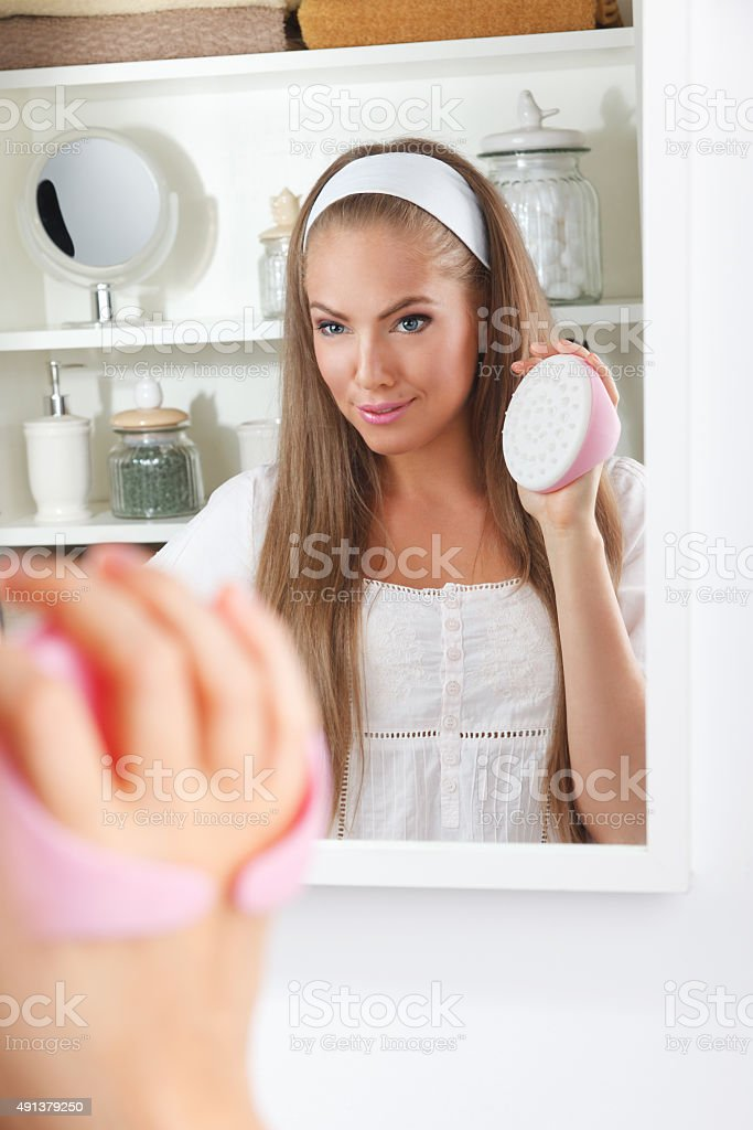 Beautiful woman holding a massager stock photo