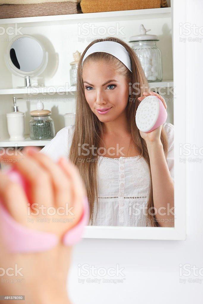 Beautiful woman holding a massager stock photo