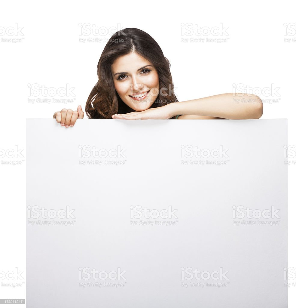 Beautiful woman holding a sign royalty-free stock photo