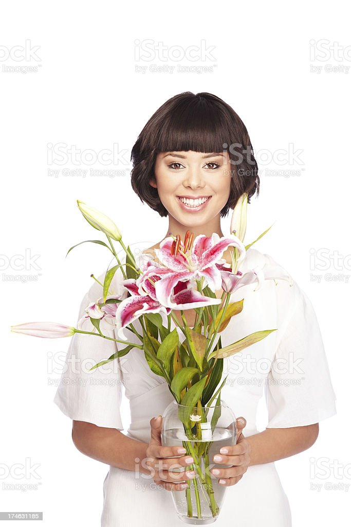 Beautiful woman holding a vase with lily flowers royalty-free stock photo