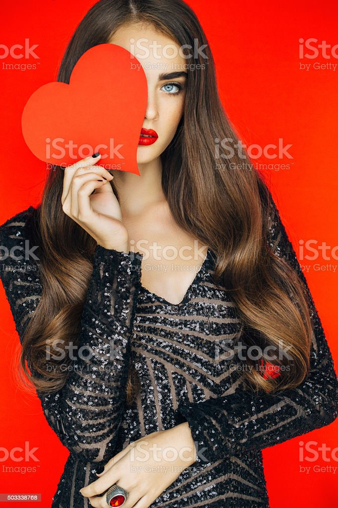 Beautiful woman holding artificial heart stock photo