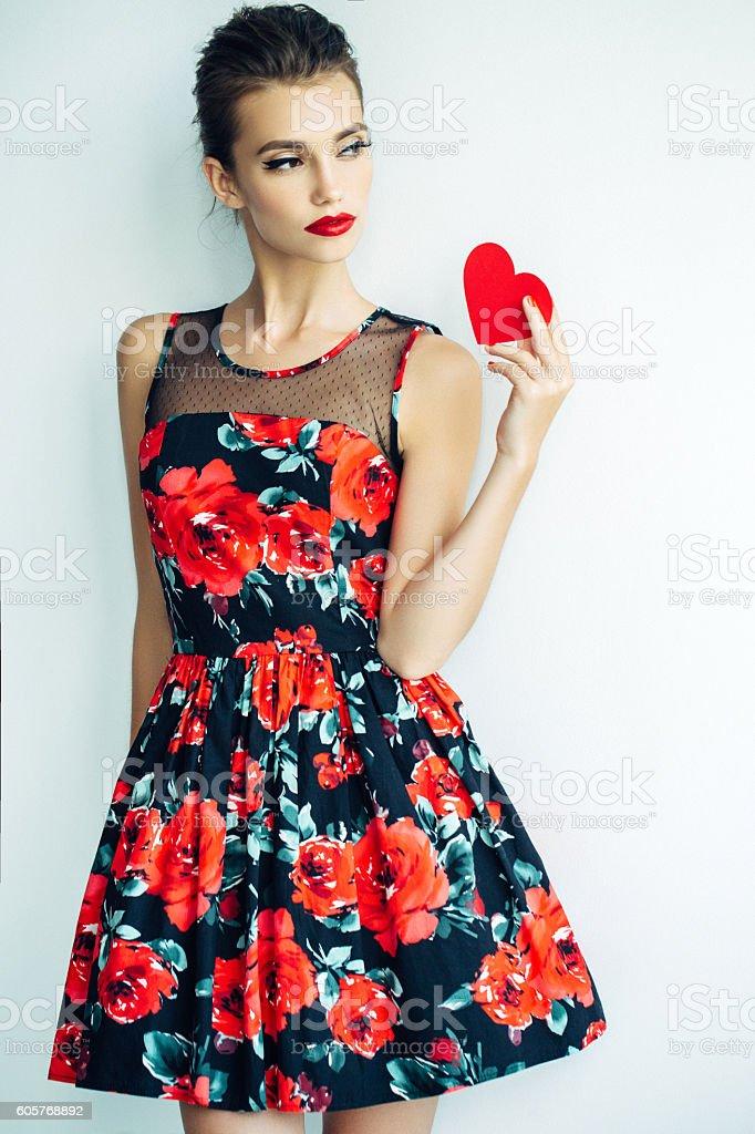 Beautiful woman holding artificial heart stock photo