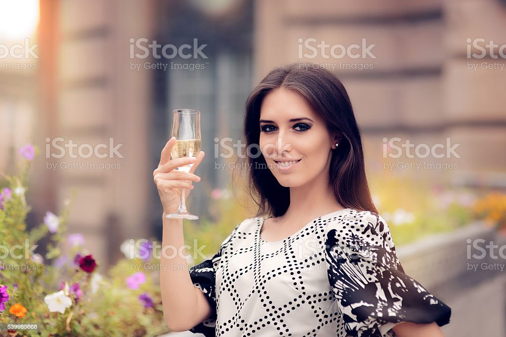 Beautiful Woman Holding Champagne Glass and Celebrating stock photo