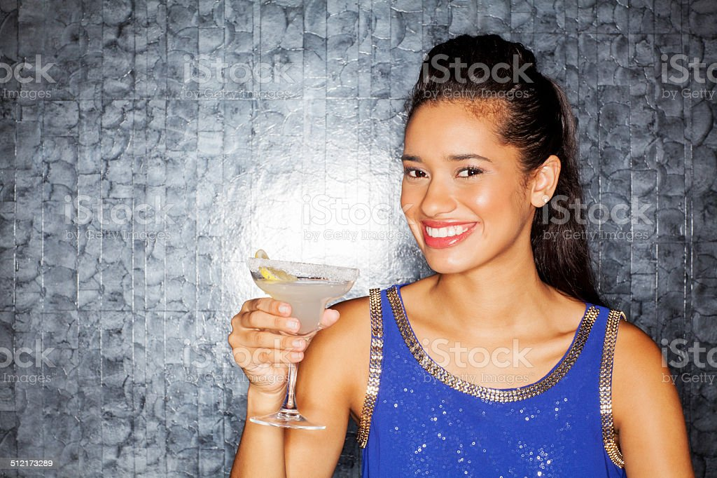 Beautiful Woman Holding Cocktail Drink In Nightclub stock photo
