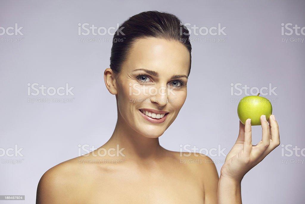 Beautiful woman holding green apple royalty-free stock photo