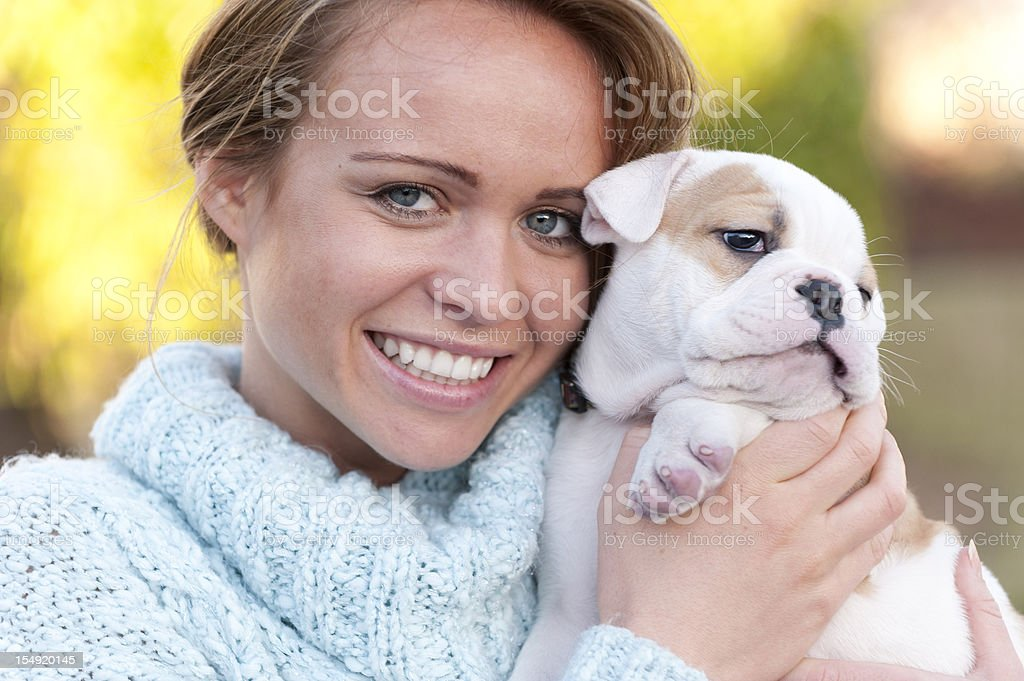Beautiful woman holding her dog stock photo