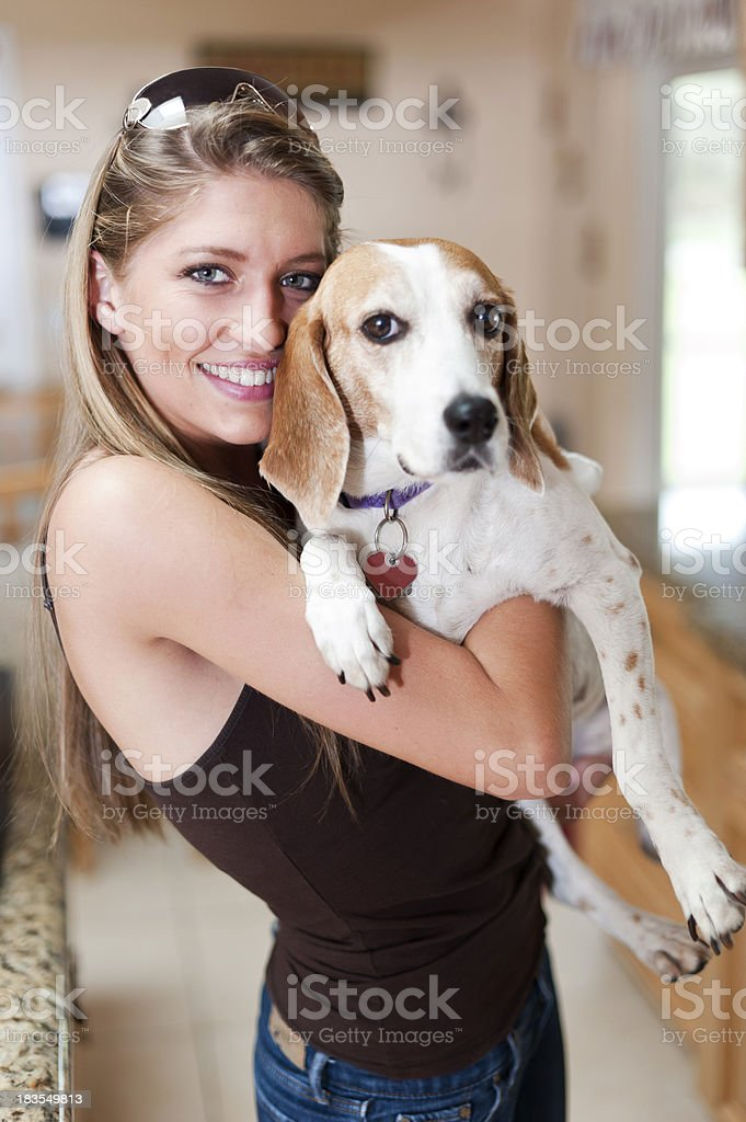 Beautiful woman holding her dog royalty-free stock photo