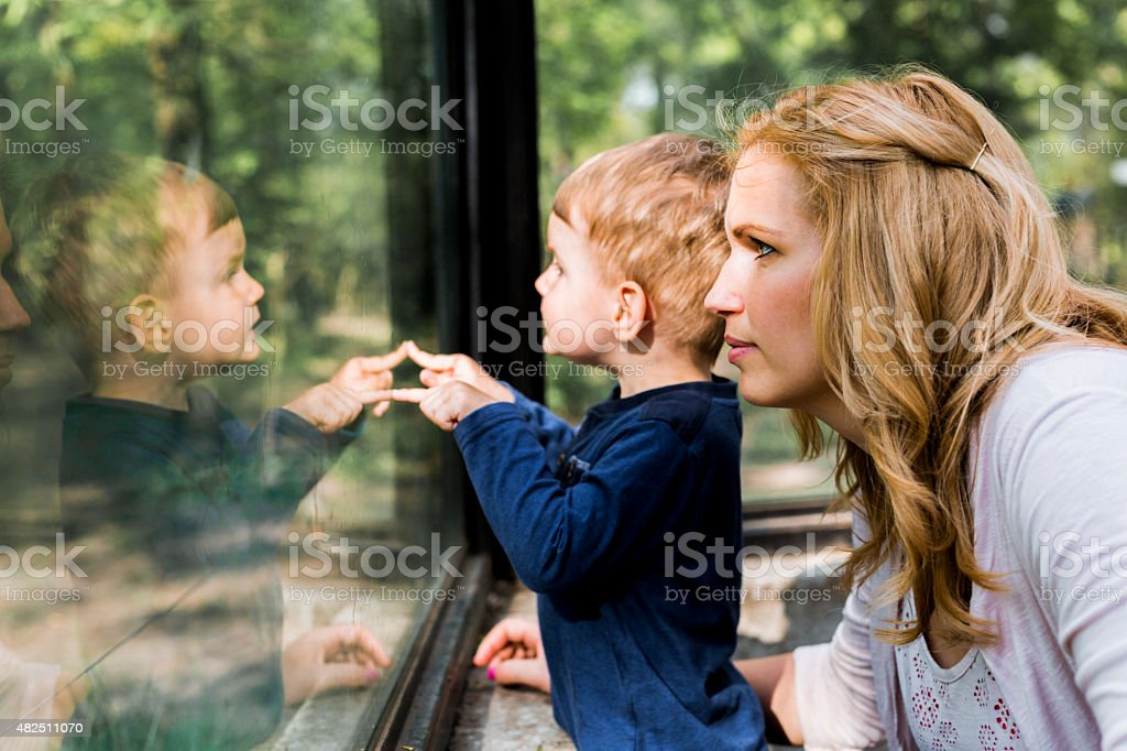 Beautiful woman holding her son stock photo