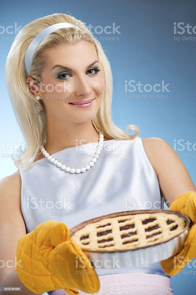 Beautiful woman holding hot italian pie. Retro stylized portrait royalty-free stock photo