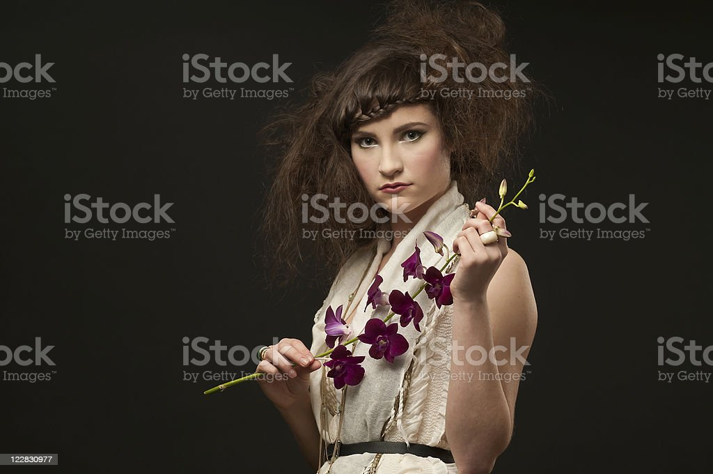 Beautiful Woman Holding Orchids royalty-free stock photo