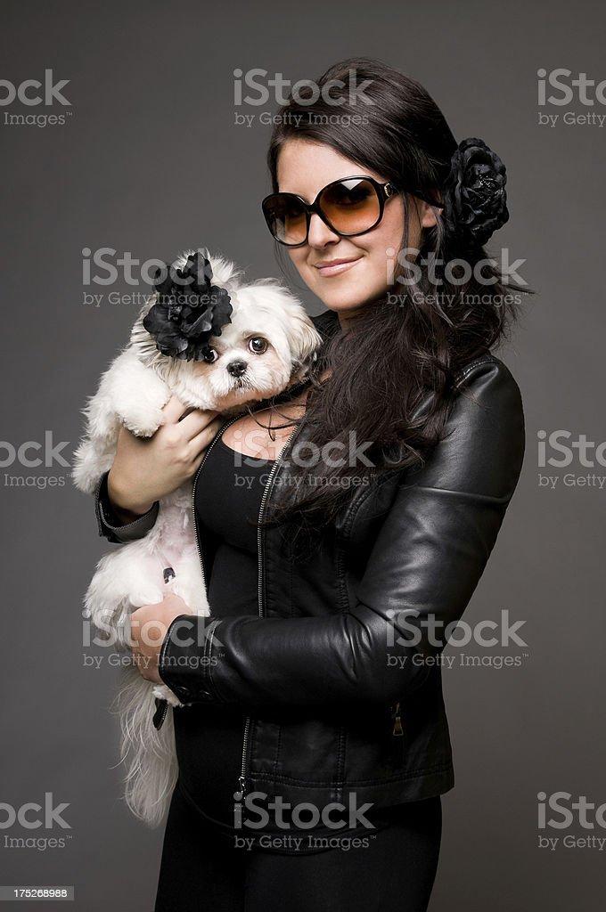 Beautiful Woman Holding Shih Tzu Poodle Dog stock photo