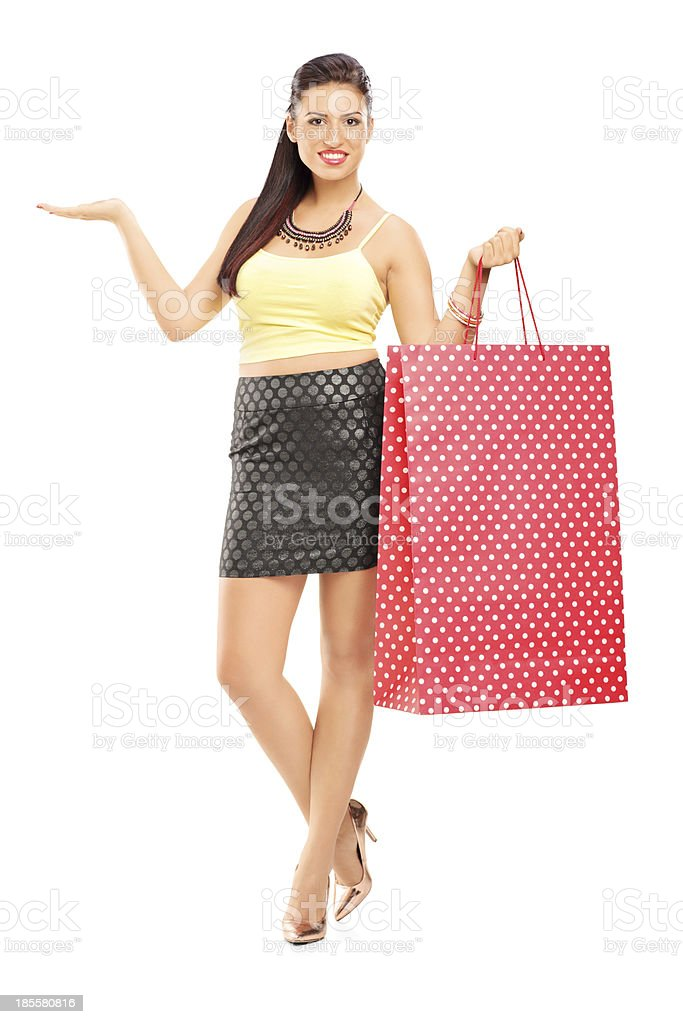 Beautiful woman holding shopping bags and gesturing royalty-free stock photo