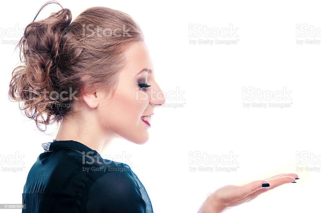 Beautiful woman holding something stock photo