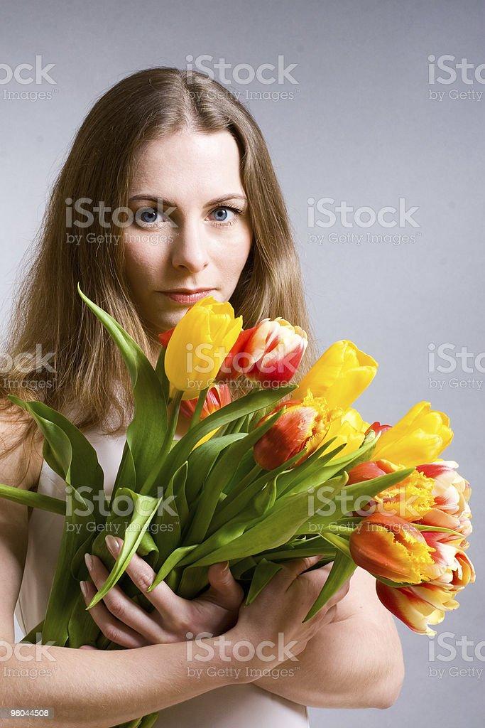 Beautiful woman holding  tulips stock photo