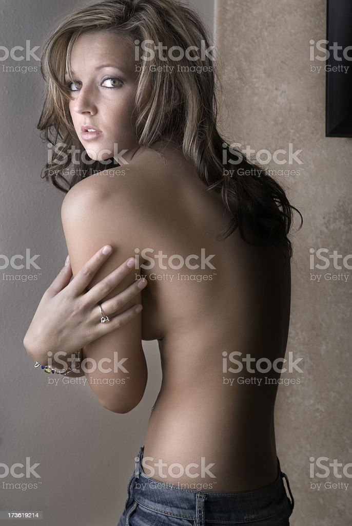 Beautiful Woman Holds Self royalty-free stock photo
