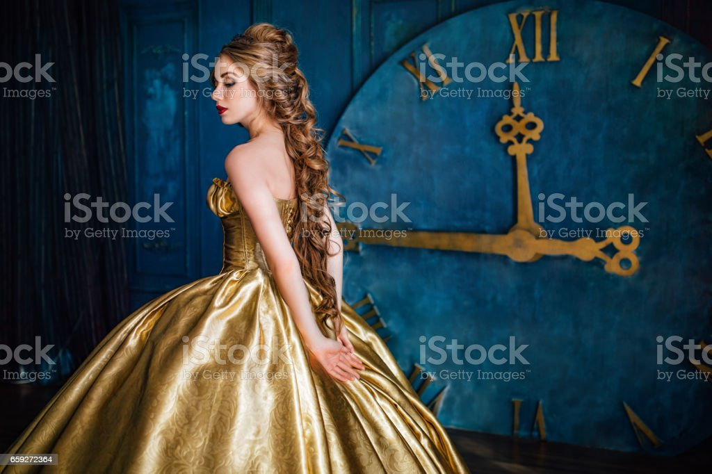 Beautiful woman in a ball gown stock photo