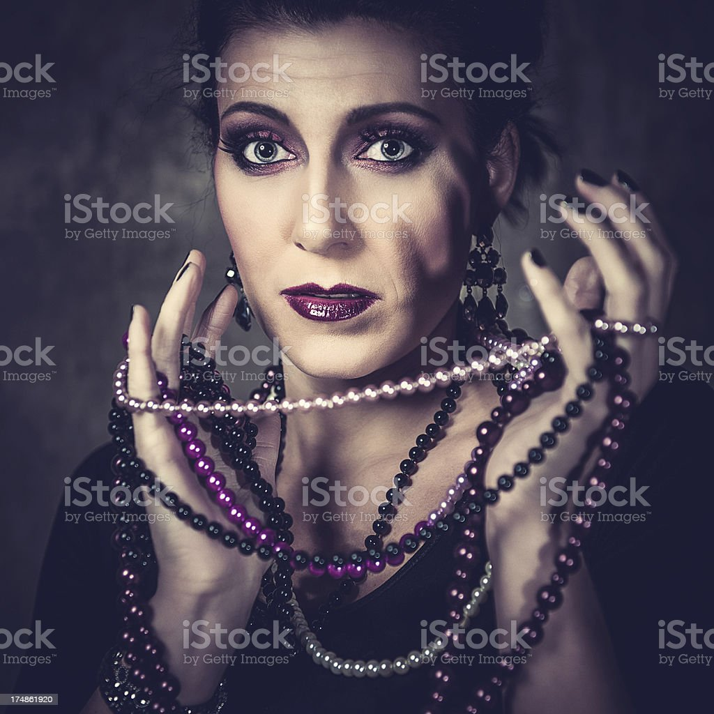 Beautiful woman in a basement stock photo
