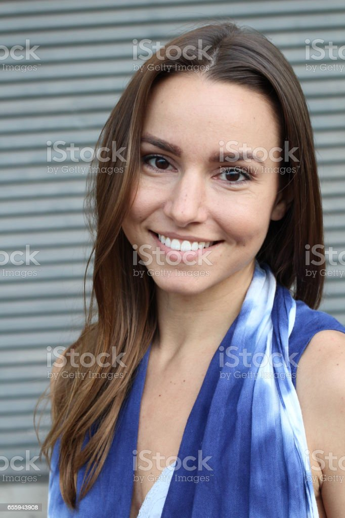 Beautiful woman in a blue dress smiling stock photo