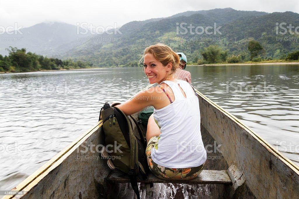 Beautiful woman in a canoe stock photo